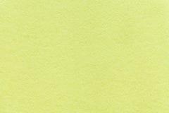 Struttura di vecchio fondo di carta verde chiaro, primo piano Struttura di cartone verde oliva denso immagini stock