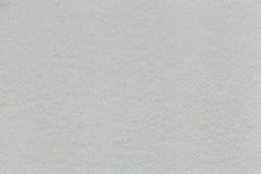Struttura di vecchio primo piano di carta grigio chiaro Struttura di un cartone denso I precedenti d'argento Immagini Stock
