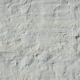 Struttura dipinta ed intonacata di retro bianco irregolare del muro di mattoni Fotografie Stock Libere da Diritti