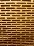 Struttura dorata della superficie di metallo di pendenza con il modello ripetitivo fotografia stock libera da diritti