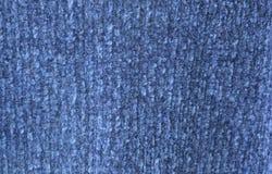 struttura e fondo blu del tessuto del maglione immagini stock