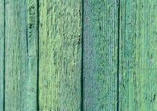Struttura e fondo di vecchio recinto di legno verde Immagine Stock