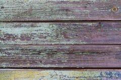 Struttura, fondo, vecchi bordi orizzontali di legno con i residui della pittura fotografia stock libera da diritti