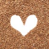 Struttura a forma di cuore fatta di grano saraceno Immagine Stock Libera da Diritti