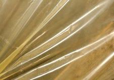 Struttura gialla del film plastico al sole Immagine Stock