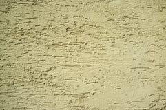 Struttura granulare gialla dell'estratto della parete immagini stock