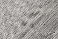 Struttura grigia del muro di cemento con le righe di rilievo Fotografie Stock Libere da Diritti