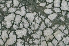 Struttura incrinata dell'asfalto invecchiata Grey Immagine Stock