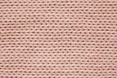 Struttura lavorata a maglia colore rosa Fotografie Stock