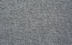 Struttura lavorata a maglia grigia del tessuto Fotografia Stock