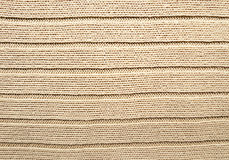 Struttura lavorata a maglia handmade beige del tessuto Fotografia Stock