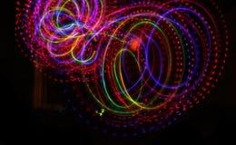 Struttura luminosa leggera variopinta sul nero immagini stock