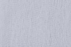 Struttura medica bianca della garza della fasciatura, macro primo piano del fondo strutturato astratto, spazio di tela della copi Fotografie Stock Libere da Diritti