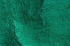 Struttura metallica verde del fondo della stagnola fotografie stock libere da diritti