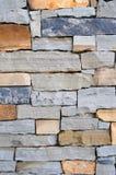 Struttura Mixed della priorità bassa della parete di pietra Immagini Stock