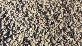 Struttura moderna della ghiaia Piccole pietre, piccole rocce, ciottoli in molte tonalità di colore grigio e bianco Fondo di picco Fotografia Stock