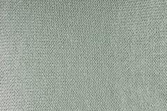 Struttura monocromatica di tricottare Fondo in bianco con i cicli L'indumento tricottato è verde pallido immagini stock libere da diritti