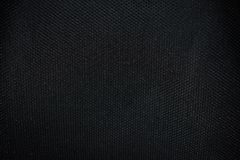 Struttura nera dei tessuti da una sedia fotografie stock