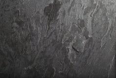 Struttura nera del fondo della roccia dell'ardesia Immagini Stock