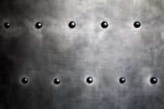 Struttura nera dell'armatura o di piastra metallica con i ribattini Immagini Stock