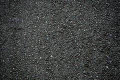 Struttura nera di terreno incolto dell'asfalto per fondo immagine stock