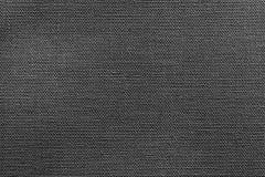 Struttura nera luminosa di tessuto o della materia tessile Fotografie Stock
