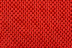 Struttura non tessuta arancio del fondo del tessuto fotografia stock libera da diritti
