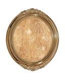 Struttura ovale dorata della foto con vecchia tela marrone dentro. Isolato. Fotografia Stock Libera da Diritti