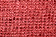 Struttura rossa del tessuto Fondo rosso del panno Chiuda sulla vista di struttura e del fondo rossi del tessuto immagini stock libere da diritti