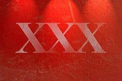 Struttura rossa Grungy della parete del cemento immagini stock