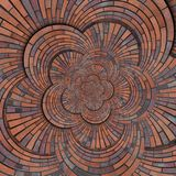 Struttura rossa marrone astratta del fondo del modello del muro di mattoni di spirale di forma del fiore Frattale a spirale roton fotografie stock