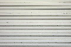 Struttura spogliata porta del garage; fondo del metallo Fotografie Stock