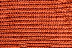 Struttura tricottata arancia Filato di lana nel tricottare fondo Fotografia Stock
