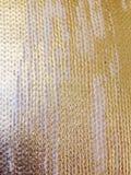 Struttura tricottata tessuta del tessuto con la pittura dell'oro Fotografia Stock