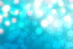 Struttura vaga brillante del fondo del turchese blu di pendenza dell'estratto con le luci circolari del bokeh Bello contesto Spaz immagini stock