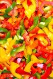 Struttura variopinta fresca dei peperoni dolci del taglio per fondo Fotografia Stock