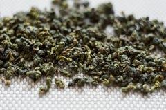 Struttura verde asciutta di macro delle foglie di tè del oolong Fotografia Stock