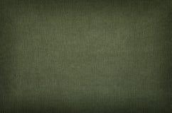 Struttura verde oliva del cotone con la scenetta Fotografia Stock