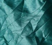 Struttura verde sgualcita del tessuto fotografia stock libera da diritti