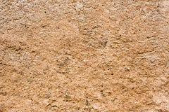 Strutture - muro di cemento brunastro fotografia stock libera da diritti