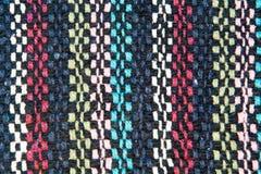 Strutturi i fili di lana del tessuto di nero, bianco, blu, rosso Fotografia Stock Libera da Diritti