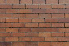 Strutturi il fondo rosso del muro di mattoni all'aperto fotografia stock libera da diritti