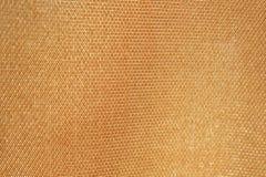 Strutturi il tessuto dorato fotografia stock libera da diritti