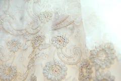 Strutturi il vestito da sposa, il panno bianco, fondo di nozze tessuto Immagine Stock Libera da Diritti