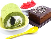 Strwberry cheesecake green tea roll cake and chocolate cake on white background Stock Photo