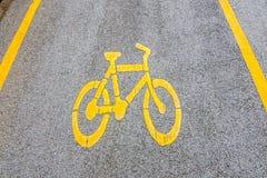 strzała bicycle ścieżki znaka kolor żółty Obraz Stock