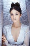 Strzelający futurystyczna młoda azjatykcia kobieta Obraz Royalty Free