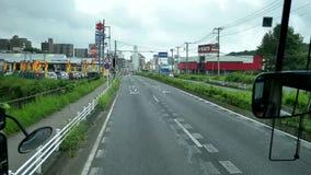 Strzelający widok wśrodku autobusu wzdłuż Japonia ulicy Narita lotnisko zdjęcie wideo