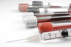 Strzykawki i badania krwi tubka Obrazy Stock