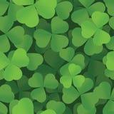 Sts Patrick mönstrar seamless bakgrund för dagshamrocken Arkivfoton